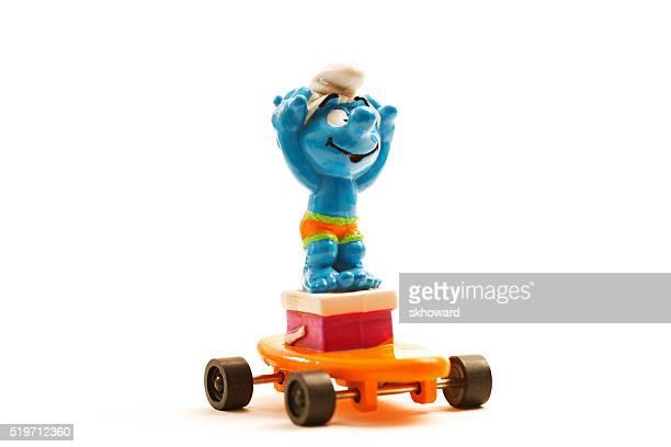 Vintage Smurf carácter num skate cor-de-laranja