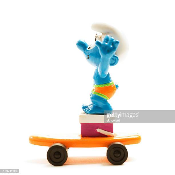 Vintage Smurf Character on an Orange Skateboard