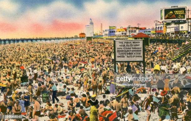 Vintage souvenir color postcard published in 1944 by Hambro Novelty Co depicts historic Coney Island Beach and Boardwalk, Brooklyn, New York City. In...