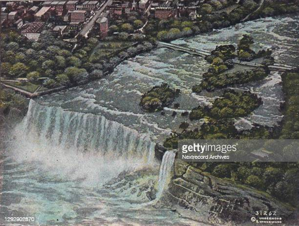 Vintage souvenir postcard published circa 1912 depicting an aerial view of the popular tourist destination and natural wonder, Niagara Falls, between...