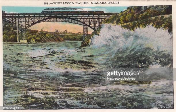 Vintage souvenir postcard published circa 1912 depicting the popular tourist destination and natural wonder, Niagara Falls, between New York State...