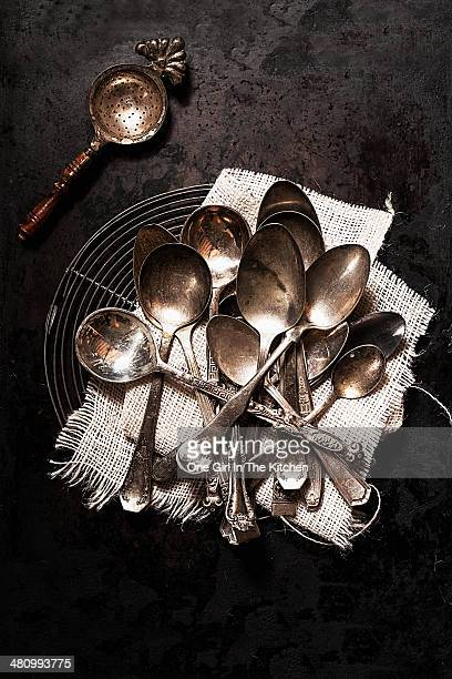 vintage spoons and strainer - tablespoon vs teaspoon stock photos and pictures