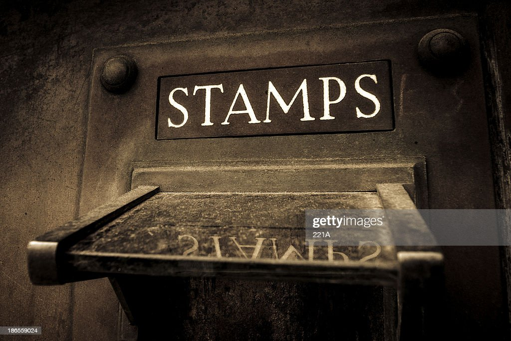 Vintage stamp vending machine : Stock Photo