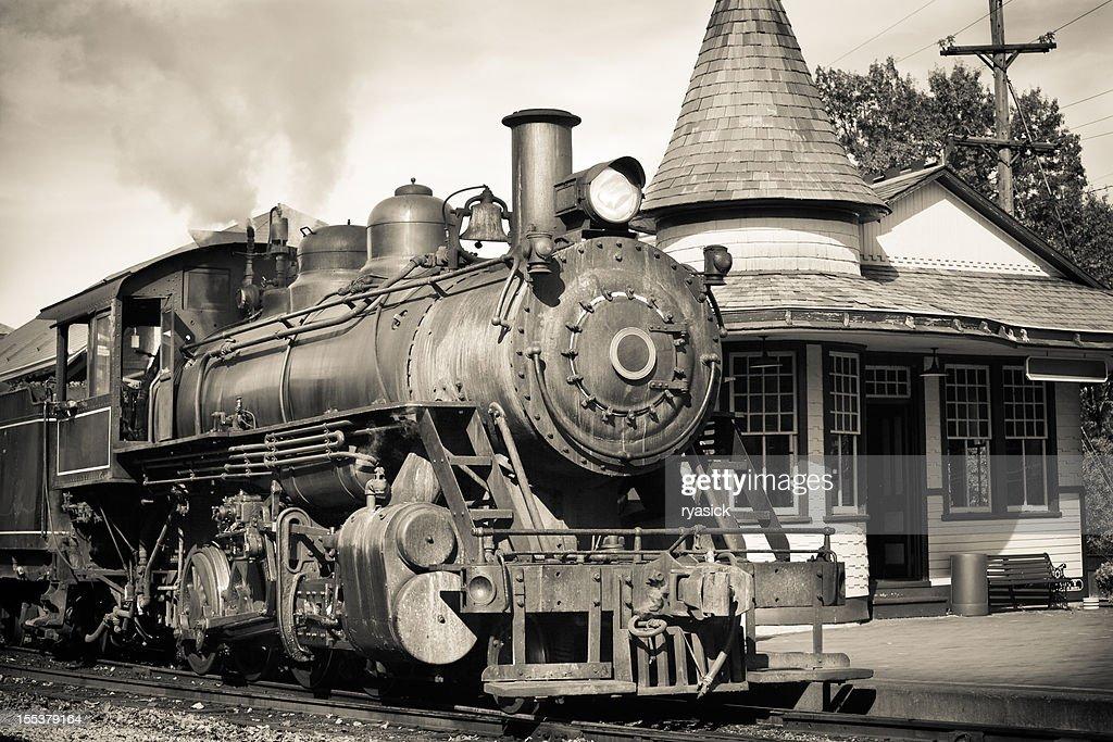 Vintage Steam Engine At Historic Train Station Platform
