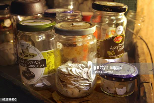 Vintage stickers are stored in glass jars in the cellar of the Bussaco Palace hotel winery on October 4 2016 near Luso in central Portugal The hotel...