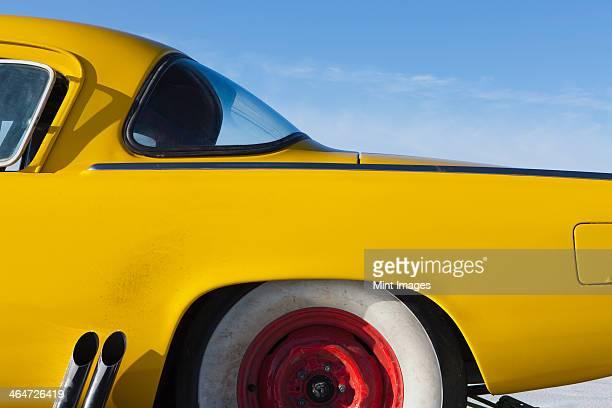 A vintage Studebaker race car,rear section,on Bonneville Salt Flats race track,during Speed Week.