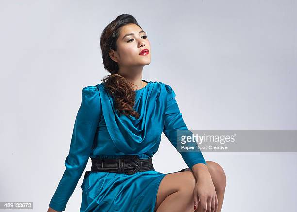 vintage style photo of a lady in a blue dress - blue dress stock pictures, royalty-free photos & images