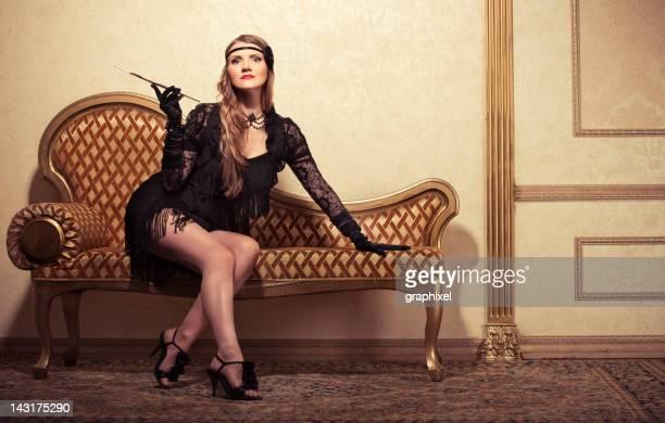 Vintage style smoking women on sofa