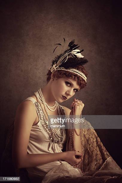 vintage style woman holding pearl necklaces