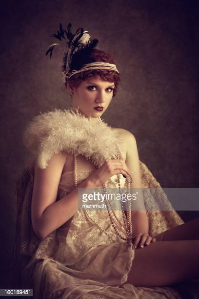vintage style woman with feather fan
