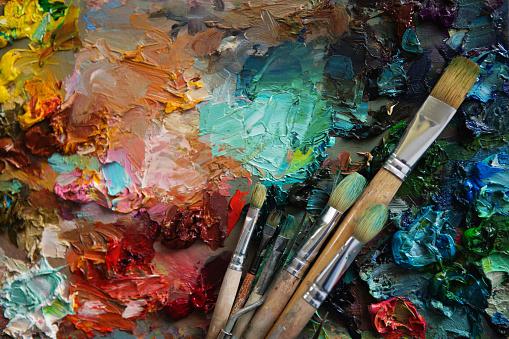 Vintage stylized photo of paintbrushes closeup and artist palett 577949148