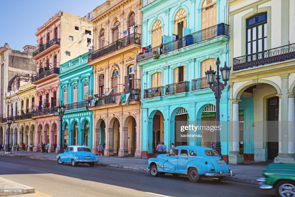Vintage taxis on street against historic buildings : Stock Photo