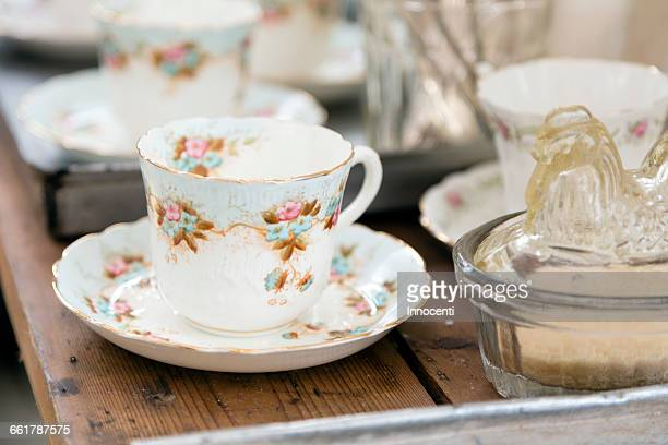 vintage teacup and saucer on wooden table - porcelain stock photos and pictures
