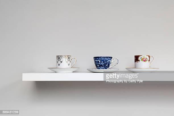 Vintage teacups on shelf
