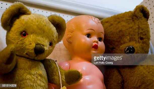 vintage teddy bears and doll in market stall - lyn holly coorg stock photos and pictures