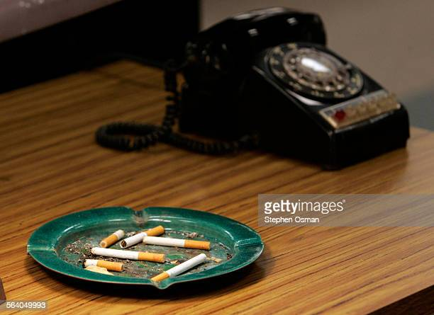 Vintage telephones and ashtrays full of cigarettes on the set of Mad Men a new AMC series about ad men in the Fifties in New York which offers a...