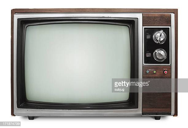 Vintage television with channel knobs on white background