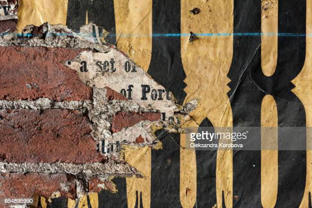 vintage textures: old poster fragments with letters. - istock stock-fotos und bilder