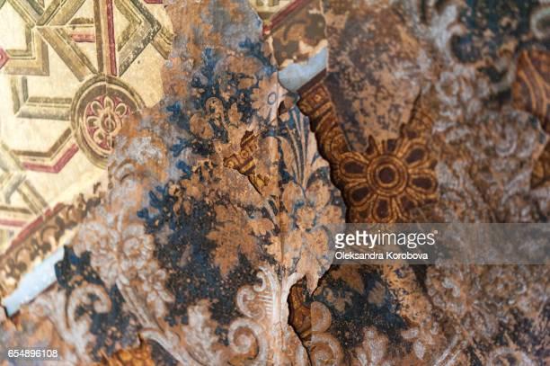 Vintage textures: old wallpaper, peeling paint, brick wall