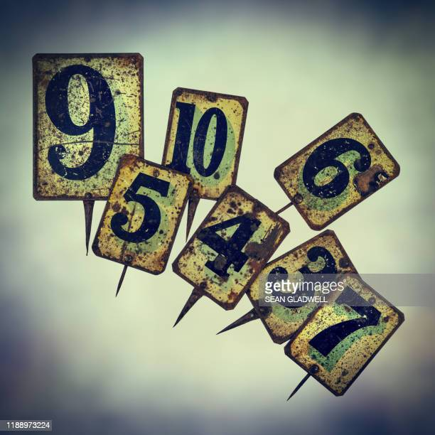 vintage tin plate numbers - bid stock pictures, royalty-free photos & images