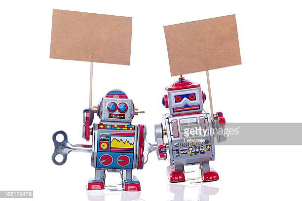 vintage tin robots - wind up toy stock photos and pictures