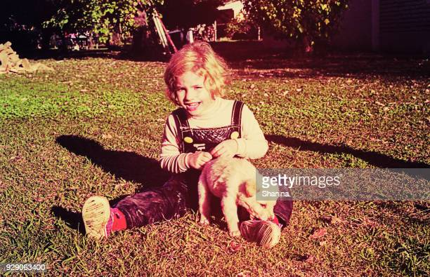 Vintage toddler with a puppy