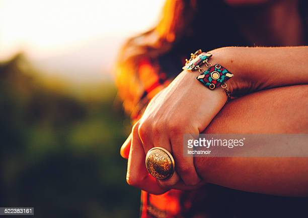 vintage toned cross processed hand with jewelry - bracelet photos stock pictures, royalty-free photos & images
