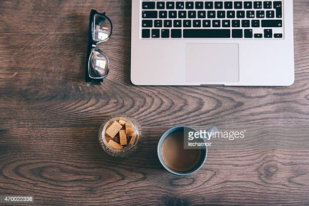 vintage toned image of coffee cup and laptop on table