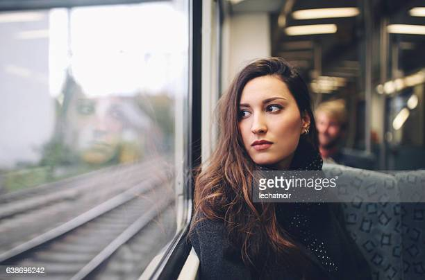 Vintage toned portrait of  a woman in Berlin metro train