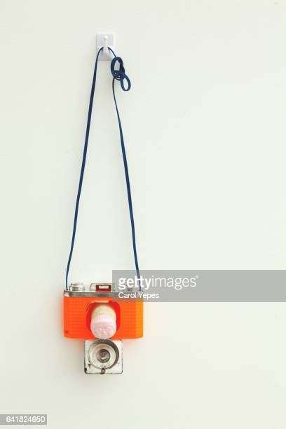 vintage toy camera hanging wall
