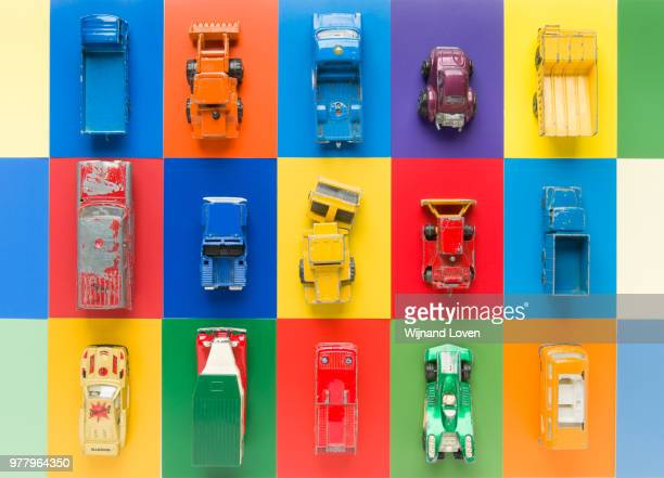 Vintage toy cars on multi-colored background