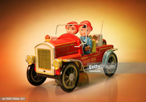 Vintage toy fire-engine with firefighters