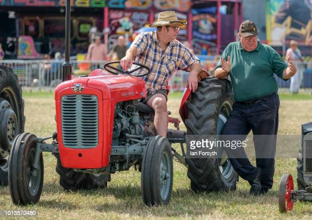 Vintage tractor owners talk as they display their tractors in the main arena during the final day of the Whitby Traction Engine Rally on August 5,...