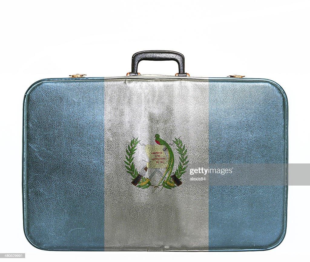 Vintage travel bag with flag of Guatemala : Stock Photo