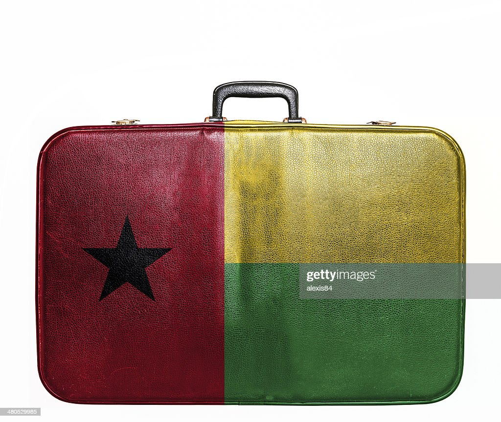 Vintage travel bag with flag of Guinea Bissau : Stock Photo