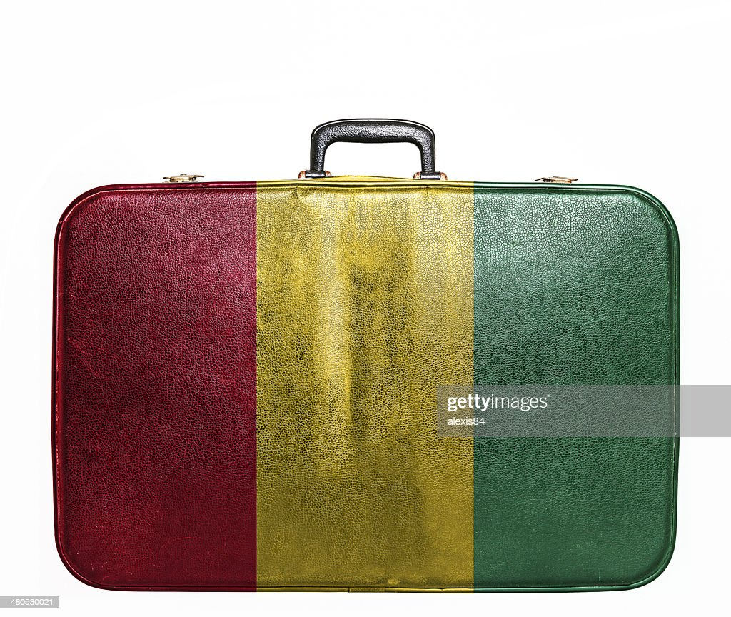 Vintage travel bag with flag of Guinea : Stock Photo