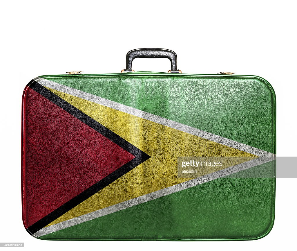 Vintage travel bag with flag of Guyana : Stock Photo
