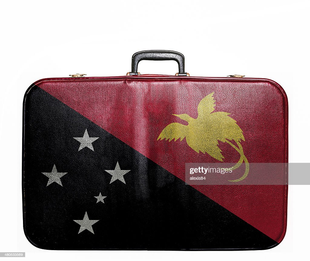 Vintage travel bag with flag of Papua New Guinea : Stock Photo