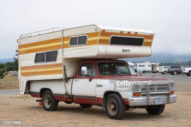 vintage truck with old camper top parked in crescent city california usa - brand name stock pictures, royalty-free photos & images