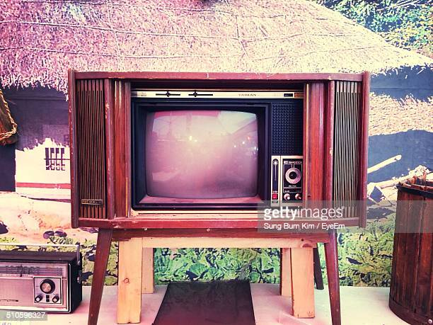 Vintage TV with radio in front of hut