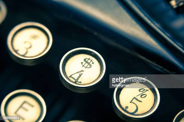 vintage typewriter dollar sign key closeup - dollar sign key stock photos and pictures