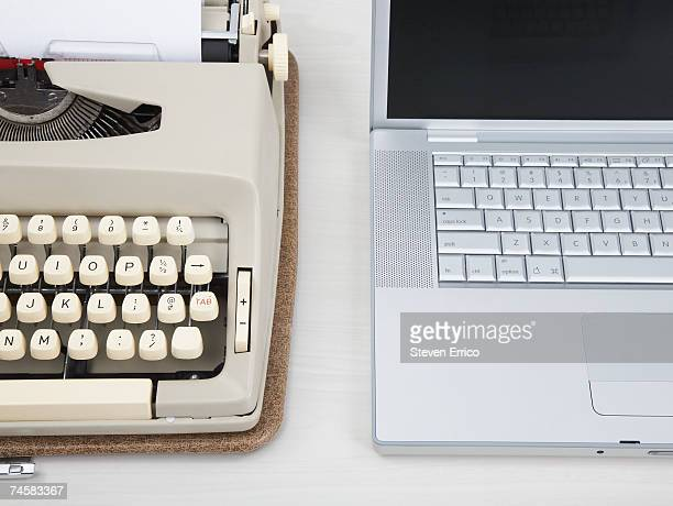 Vintage typewriter next to laptop computer, close-up