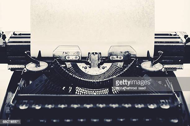 Vintage typewriter with a  blank piece of paper