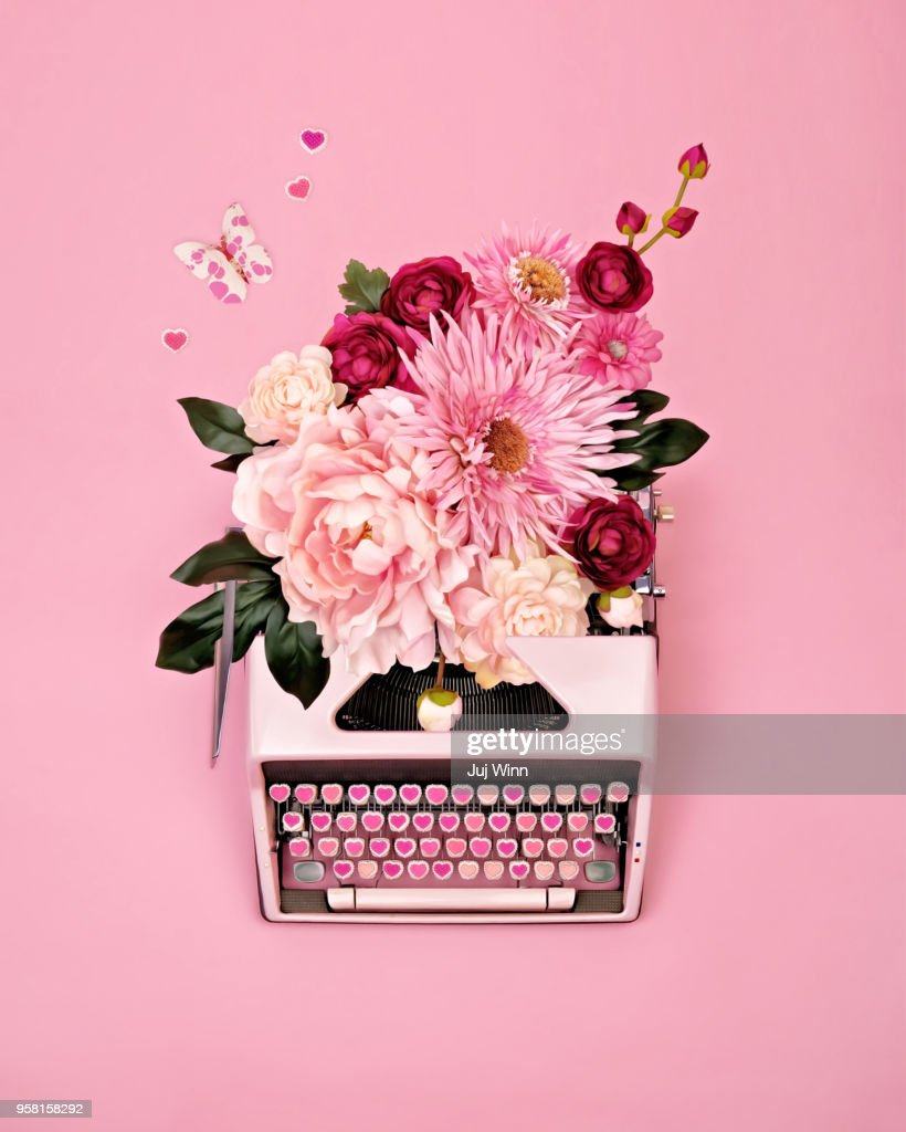 Vintage typewriter with flowers : Stock Photo