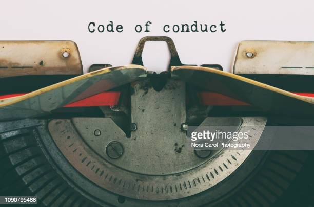 vintage typewriter with text - code of conduct - honesty stock pictures, royalty-free photos & images