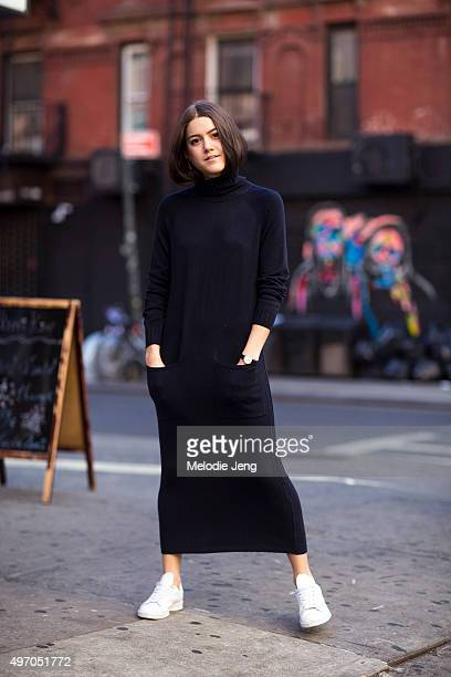 A Vintage Vice Blogger and stylist Emma Sousa wears a dark blue Whistles sweater dress a Nicholas Keith watch and white Adidas Stan Smith sneakers in...