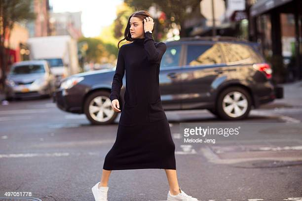 A Vintage Vice Blogger and stylist Emma Sousa wears a dark blue Whistles sweater dress a Nicholas Keith watch and Verre and vintage rings and white...