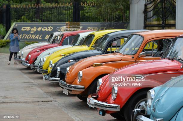 Vintage Volkswagen Beetle cars are parked in a row during a rally held as part of the 23rd anniversary of World Wide VW Beetle Day in Bangalore on...
