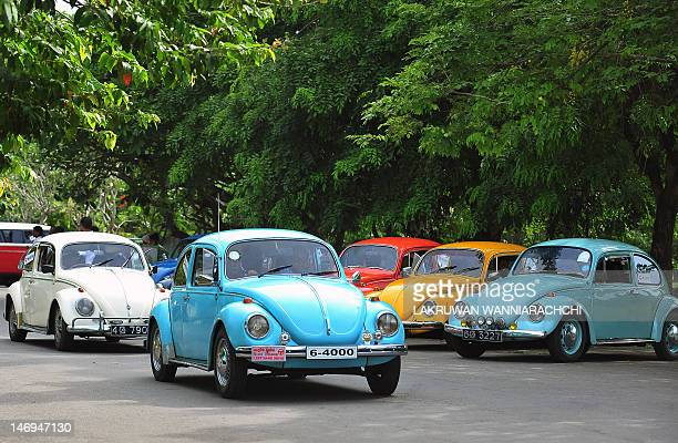 A vintage Volkswagen Beetle cars drives in Colombo on June 24 during Volkswagen Day celebrations in Sri Lanka Volkswagen owners hold an annual...