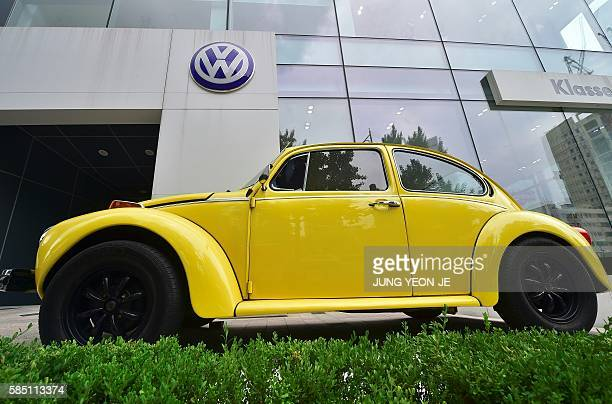 A vintage Volkswagen Beetle is displayed outside a Volkswagen Korea showroom in Seoul on August 2 2016 South Korea on August 2 said it was suspending...